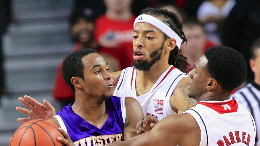 Western Illinois guard Jabari Sandifer, left, is defended by Nebraska forward Terran Petteway, center, and guard Benny Parker (3) in the second half of an NCAA college basketball game in Lincoln, Neb., Tuesday, Nov. 12, 2013. (AP Photo/Nati Harnik)
