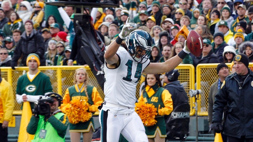FILE - In this Nov. 10, 2013 file photo, Philadelphia Eagles' Riley Cooper reacts as he crosses the goal line after catching a 32-yard touchdown pass during the second half of an NFL football game against the Green Bay Packers, in Green Bay,Wis. After an invisible first month of the season, Cooper has developed into a legitimate deep threat with five touchdown receptions in the Eagles' last two games.  (AP Photo/Mike Roemer, File)