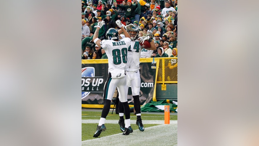 Philadelphia Eagles' Riley Cooper (14) celebrates with teammate Jeff Maehl after catching a 32-yard touchdown pass during the second half of an NFL football game against the Green Bay Packers Sunday, Nov. 10, 2013, in Green Bay, Wis. The Eagles won 27-13. (AP Photo/Mike Roemer)