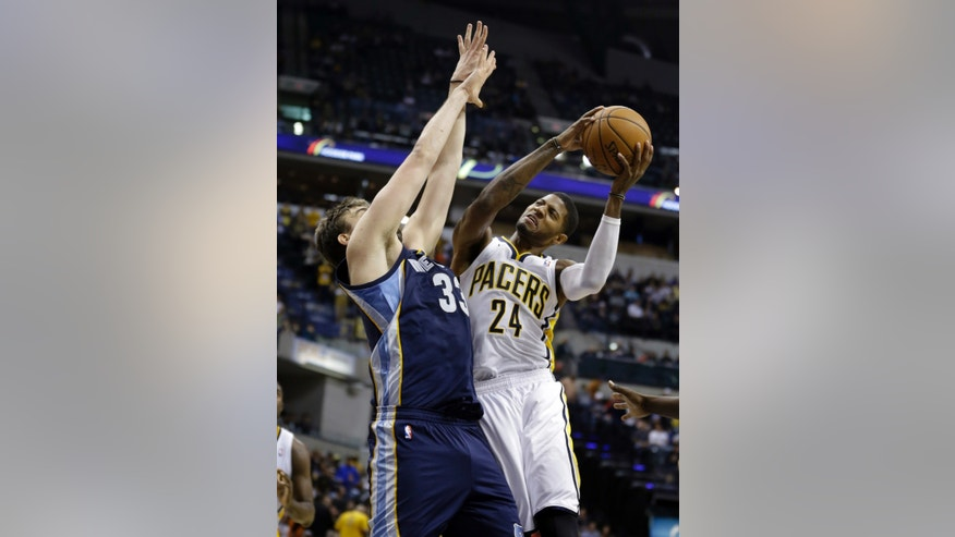 Indiana Pacers forward Paul George, right, is hit by Memphis Grizzlies center Marc Gasol, of Spain as he shoots in the second half of an NBA basketball game in Indianapolis, Monday, Nov. 11, 2013. The Pacers defeated the Grizzlies 95-79. (AP Photo/Michael Conroy)