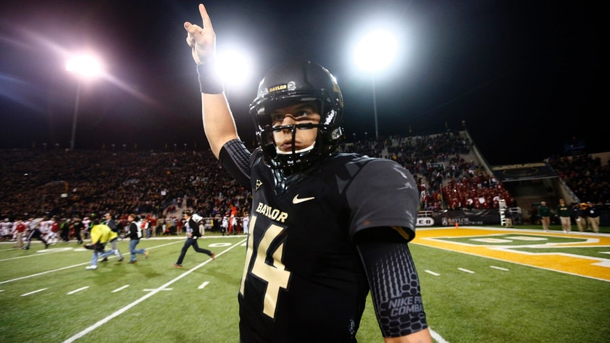 Baylor Bears quarterback Bryce Petty (14) celebrates on the field as the final seconds tick off the clock on their 41-12 win over the Oklahoma Sooners at Floyd Casey Stadium in Waco, Thursday, Nov. 7, 2013.  (AP Photo/The Dallas Morning News, Tom Fox)