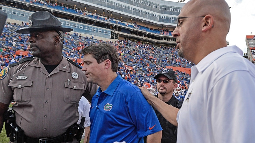 Vanderbilt coach James Franklin, right, gives Florida coach Will Muschamp, left, a pat on the back after Vanderbilt defeated Florida 34-17 in an NCAA college football game Saturday, Nov. 9, 2013, in Gainesville, Fla.  (AP Photo/Phil Sandlin)