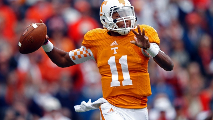 Tennessee quarterback Joshua Dobbs (11) throws to a receiver during the first quarter of an NCAA college football game against Auburn on Saturday, Nov. 9, 2013, in Knoxville, Tenn. (AP Photo/Wade Payne)