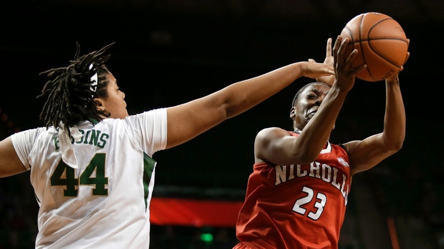 Baylor's Kristina Higgins (44) defends against a shot attempt by Nicholls State's Jasmine Scott (23) in the first half of an NCAA college basketball game, Thursday, Nov. 14, 2013, in Waco, Texas. (AP Photo/Tony Gutierrez)