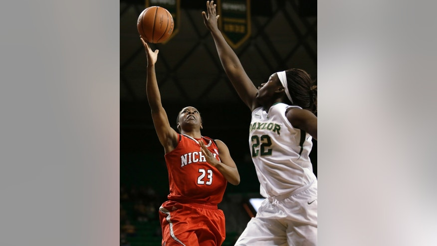 Nicholls State forward Jasmine Scott (23) goes up for a shot as Baylor's Sune Agbuke (22) defends in the first half of an NCAA college basketball game, Thursday, Nov. 14, 2013, in Waco, Texas. (AP Photo/Tony Gutierrez)