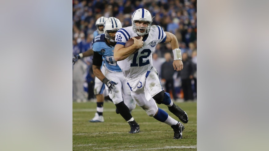 Indianapolis Colts quarterback Andrew Luck (12) scores a touchdown on an 11-yard run as Tennessee Titans defensive end Derrick Morgan (91) chases him during the third quarter of an NFL football game Thursday, Nov. 14, 2013, in Nashville, Tenn. (AP Photo/Wade Payne)