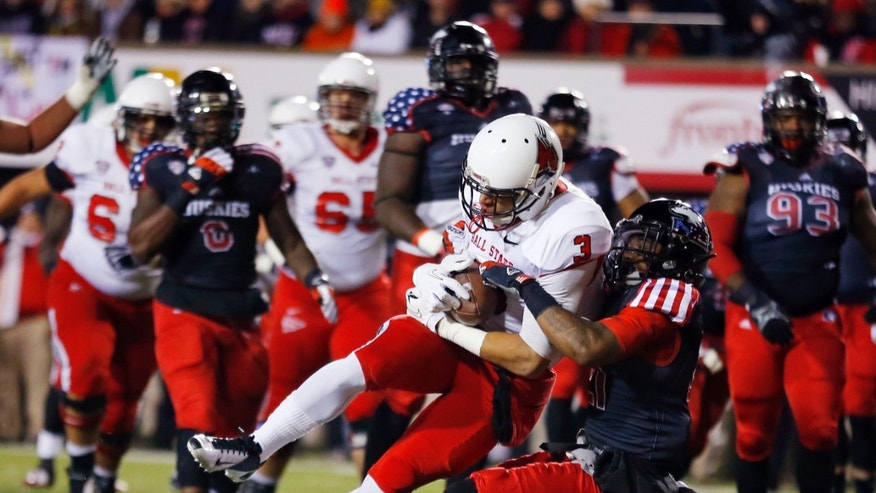 Ball State wide receiver Willie Snead (3) catches a touchdown pass as Northern Illinois cornerback Marlon Moore (21) tries to defend on the play during the first half of an NCAA college football game Wednesday, Nov. 13, 2013, in DeKalb, Ill. (AP Photo/Jeff Haynes)