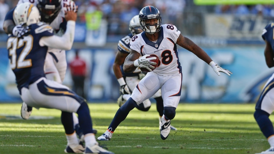 Denver Broncos wide receiver Demaryius Thomas follows his blockers on his way to a 34 yard touchdown reception against the San Diego Chargers in the second half of a NFL football game Sunday, Nov. 10, 2013, in San Diego. (AP Photo/Gregory Bull)