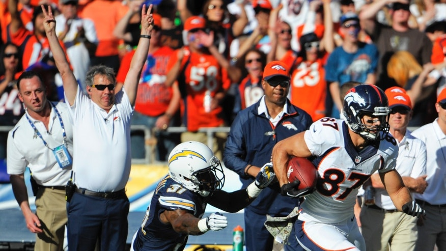 Denver Broncos wide receiver Eric Decker breaks away from San Diego Chargers defensive back Jahleel Addae after catching a pass during second quarter of a NFL football game Sunday, Nov. 10, 2013, in San Diego. (AP Photo/Denis Poroy)