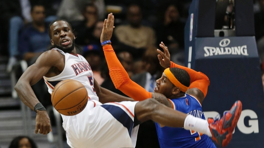 Atlanta Hawks forward DeMarre Carroll (5) and New York Knicks forward Carmelo Anthony (7) watch the ball in the first half of an NBA basketball game Wednesday, Nov. 13, 2013, in Atlanta. (AP Photo/John Bazemore)