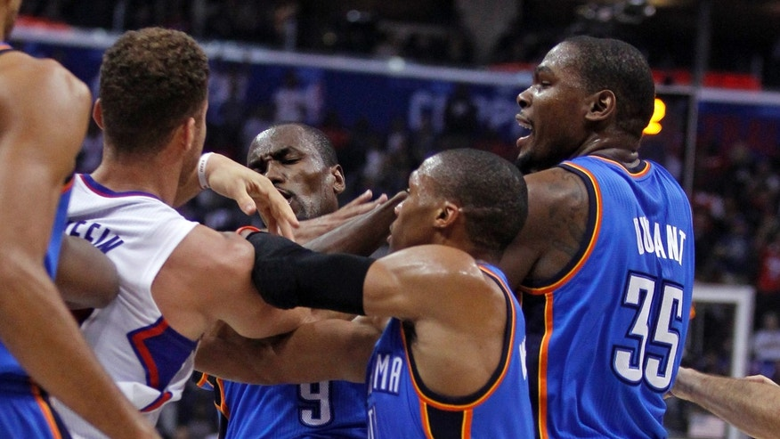 Los Angeles Clippers forward Blake Griffin, left, gets into a skirmish with Oklahoma City Thunder forward Serge Ibaka (9), forward Kevin Durant, right, and guard Russell Westbrook, second form right, in the first half of an NBA basketball game Wednesday, Nov. 13, 2013, in Los Angeles. Ibaka and Clippers forward Matt Barnes were ejected. (AP Photo/Alex Gallardo)