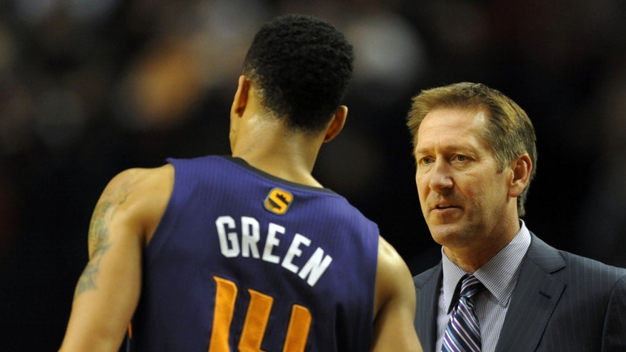Phoenix Suns head coach Jeff Hornacek, right, speaks with shooting guard Gerald Green (14) during the first quarter of an NBA basketball game against the Portland Trail Blazers, Wednesday, Nov. 13, 2013, in Portland, Ore. (AP Photo/Steve Dykes)