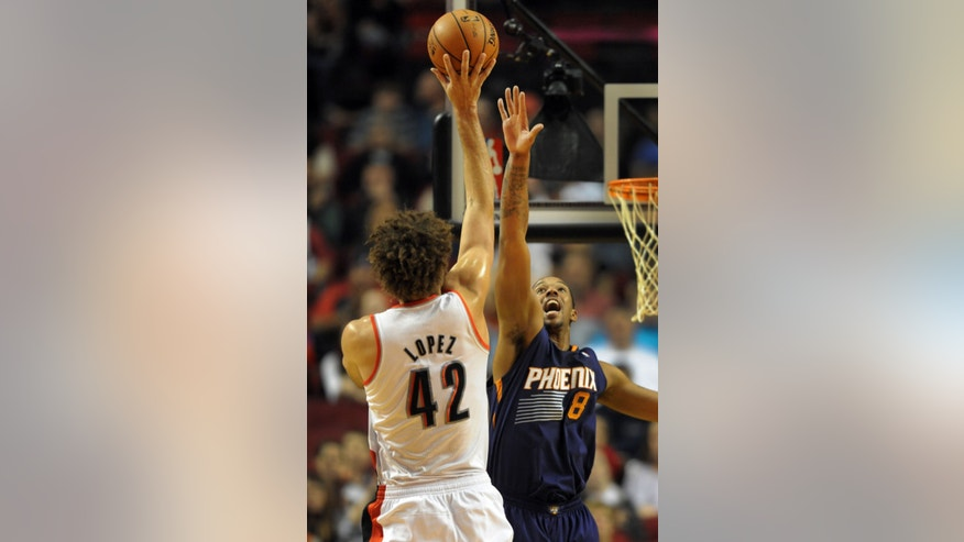 Portland Trail Blazers center Robin Lopez (42) shoots over Phoenix Suns power forward Channing Frye (8) during the first quarter of an NBA basketball game on Wednesday, Nov. 13, 2013, in Portland, Ore. (AP Photo/Steve Dykes)