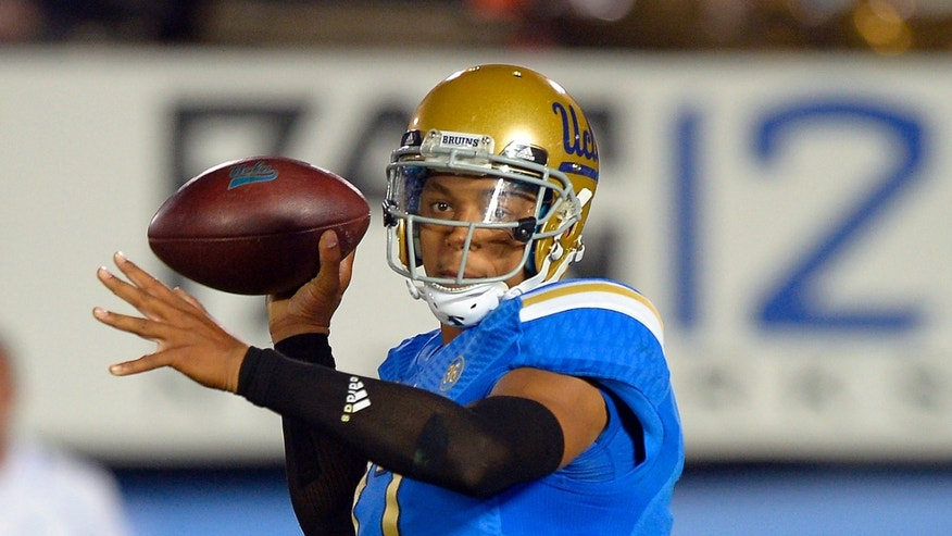 In this photo taken on Oct. 12, 2013, UCLA quarterback Brett Hundley passes during the first half of an NCAA college football game against California in Pasadena, Calif. Hundley is grateful No. 13 UCLA still controls its destiny in the Pac-12 South title race, but he realizes the Bruins probably must outscore high-flying Washington to get there on Friday night at the Rose Bowl. (AP Photo/Mark J. Terrill)