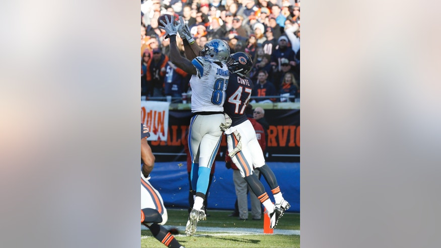 Chicago Bears safety Chris Conte (47) breaks up a pass intended for Detroit Lions wide receiver Calvin Johnson (81) in the end zone during the second half of an NFL football game, Sunday, Nov. 10, 2013, in Chicago. (AP Photo/Charles Rex Arbogast)