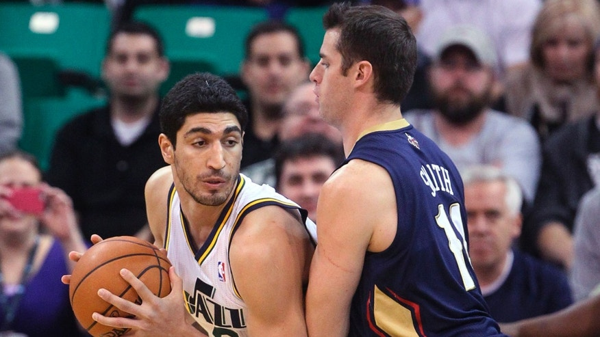New Orleans Pelicans' Jason Smith (14) defends Utah Jazz's Enes Kanter, left, during the first quarter of an NBA basketball game Wednesday, Nov. 13, 2013, in Salt Lake City. (AP Photo/Rick Bowmer)