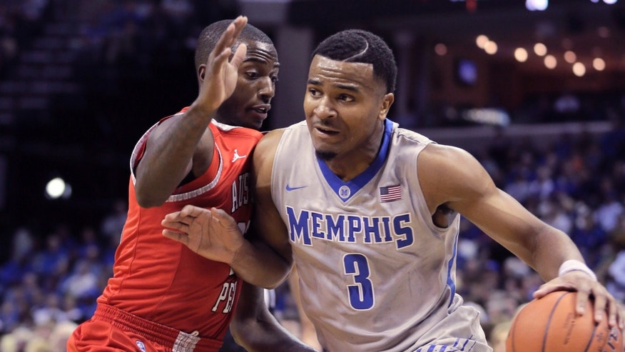Memphis' Chris Crawford (3) dribbles past Austin Peay's Damarius Smith in the first half of an NCAA college basketball game in Memphis, Tenn., Thursday, Nov. 14, 2013. (AP Photo/Danny Johnston)