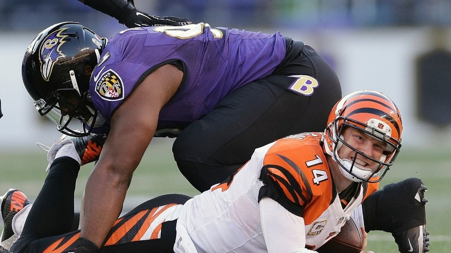Cincinnati Bengals quarterback Andy Dalton looks back toward the bench after being sacked by Baltimore Ravens defensive end DeAngelo Tyson during the second half of a NFL football game in Baltimore, Sunday, Nov. 10, 2013. (AP Photo/Patrick Semansky)
