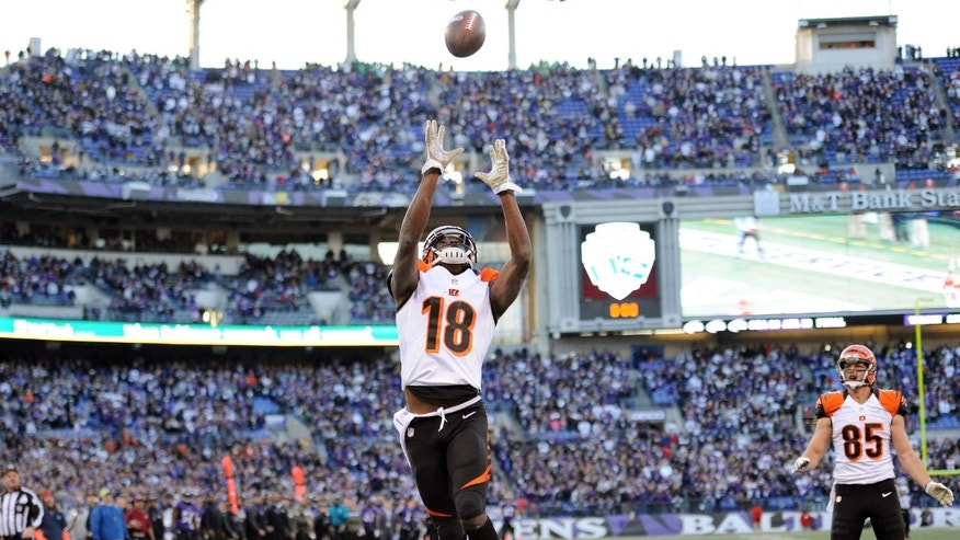 Cincinnati Bengals wide receiver A.J. Green reaches for a bobbled ball for a touchdown to tie the game as Baltimore Ravens cornerback Corey Graham looks during the second half of a NFL football game against the Baltimore Ravens in Baltimore, Sunday, Nov. 10, 2013. (AP Photo/Nick Wass)