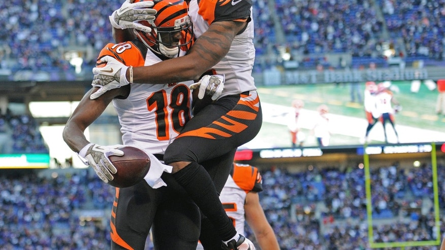 Cincinnati Bengals wide receiver A.J. Green (18) celebrates his touchdown with teammate wide receiver Mohamed Sanu during the second half of a NFL football game in Baltimore, Sunday, Nov. 10, 2013. Green grabbed a bobbled ball in the end zone to tie the game and send it into overtime. (AP Photo/Nick Wass)