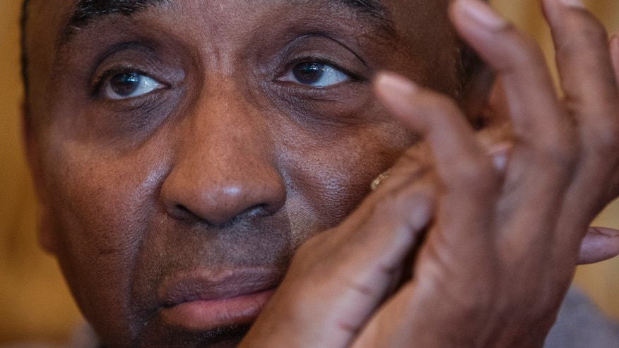 In this photo from Nov. 6, 2013, Johnny Rodgers pauses during an interview with the Associated Press in Omaha, Neb. On Thursday, Nov. 14, 2013, the 1972 Heisman Trophy winner will ask the Nebraska Board of Pardons to pardon his 1970 felony conviction for robbing a gas station. (AP Photo/Nati Harnik)
