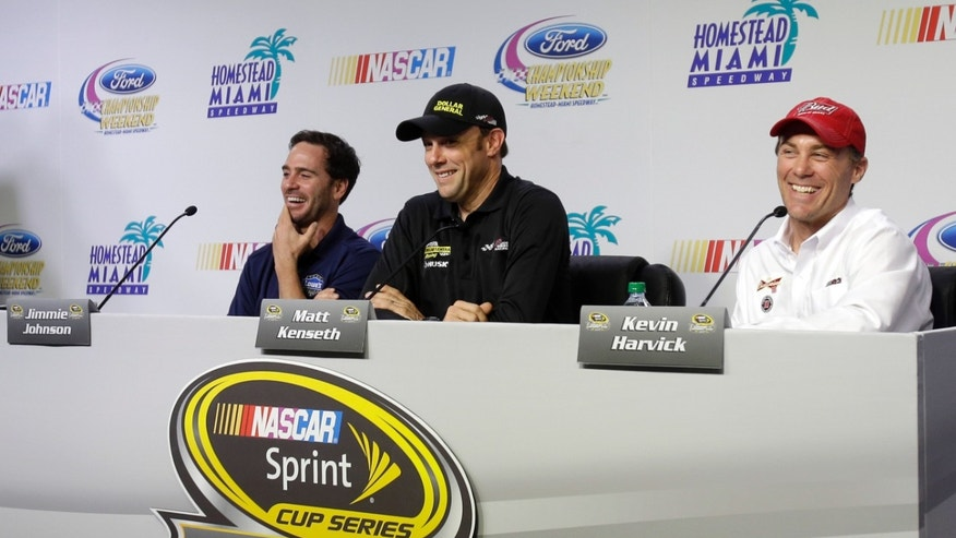NASCAR drivers Jimmie Johnson, left, Matt Kenseth, center, and Kevin Harvick, right, laugh as they prepare to answer a questions during a news conference Thursday, Nov. 14, 2013 at the Homestead-Miami Speedway in Homestead, Fla. Johnson, Kenseth, and Kevin Harvick will be competing in Sunday's NASCAR Sprint Cup series race. (AP Photo/Alan Diaz)