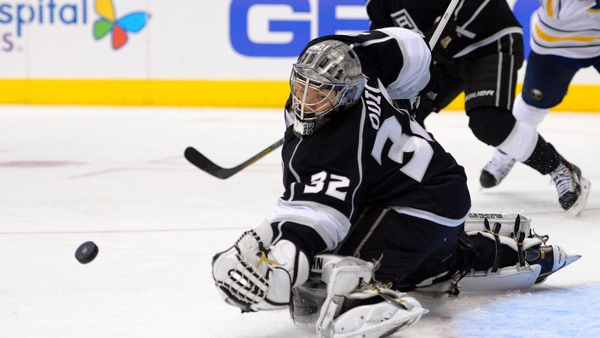 Los Angeles Kings goalie Jonathan Quick stops a shot during the third period of an NHL hockey game against the Buffalo Sabres, Thursday, Nov. 7, 2013, in Los Angeles. The Kings won 2-0.  (AP Photo/Mark J. Terrill)