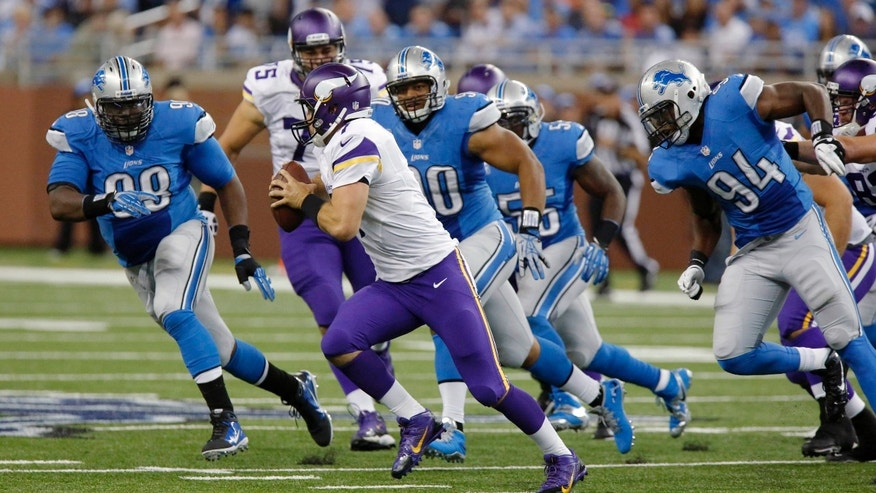 FILE - In this Sept. 8, 2013, file photo, Minnesota Vikings quarterback Christian Ponder (7) is chased by Detroit Lions defensive tackle Nick Fairley (98), defensive tackle Ndamukong Suh (90) and defensive end Ezekiel Ansah (94) during an NFL football game in Detroit. Suh and Fairley are a tandem to be feared this season. Drafted in the first round a season apart, they're anchoring a defense that is a big part of why the Lions are in first place in the NFC North. (AP Photo/Duane Burleson, File)