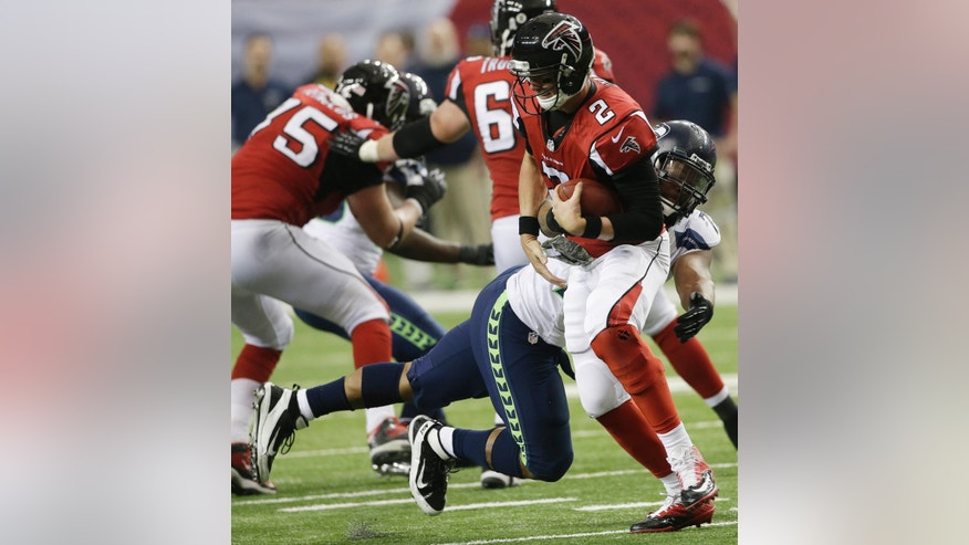 Seattle Seahawks defensive end Michael Bennett (72) hits Atlanta Falcons quarterback Matt Ryan (2) during the second half of an NFL football game, Sunday, Nov. 10, 2013, in Atlanta. (AP Photo/John Bazemore)