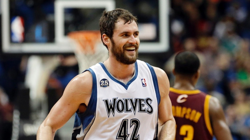 Minnesota Timberwolves' Kevin Love smiles after a three-point shot in the second half of an NBA basketball game against the Cleveland Cavaliers, Wednesday, Nov. 13, 2013, in Minneapolis. Love led the Timberwolves with 33 points in the team's 124-95 win. (AP Photo/Jim Mone)