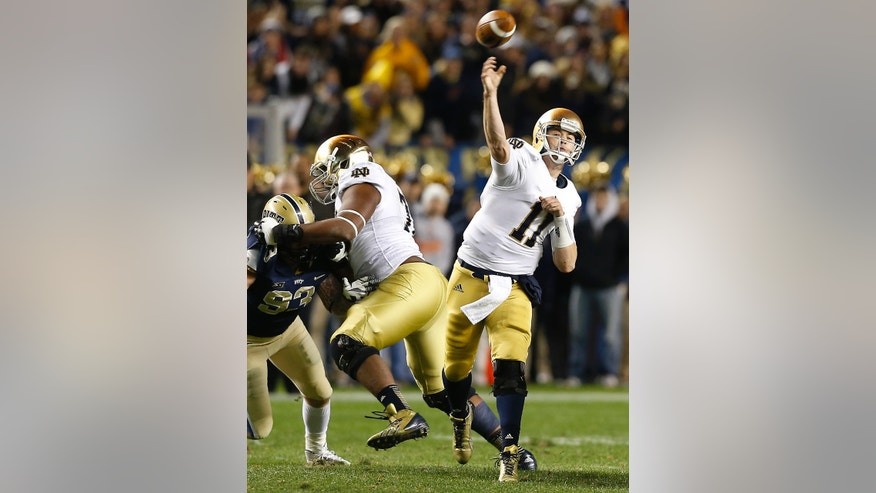 ADVANCE FOR WEEKEND EDITIONS, NOV. 16- 17 - FILE - In this Nov. 9, 2013, file photo, Notre Dame quarterback Tommy Rees (11) throws a passes against Pittsburgh during the fourth quarter of an NCAA college football game in Pittsburgh. He's been pulled from games for playing poorly, booed loudly and been arrested. But Rees is also a favorite among teammates and will be near the top of several all-time passing lists when it's all said and done. (AP Photo/Keith Srakocic, File)