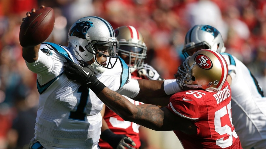 Carolina Panthers quarterback Cam Newton (1) is sacked by San Francisco 49ers linebacker Ahmad Brooks (55) during the first quarter of an NFL football game in San Francisco, Sunday, Nov. 10, 2013. (AP Photo/Marcio Jose Sanchez)