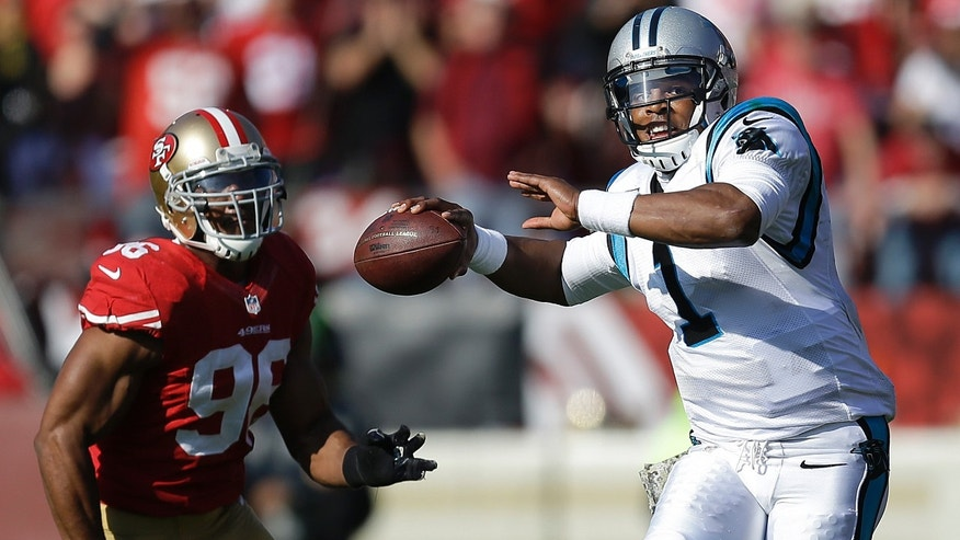 Carolina Panthers quarterback Cam Newton (1) passes as San Francisco 49ers linebacker Corey Lemonier (96) pursues during the first quarter of an NFL football game in San Francisco, Sunday, Nov. 10, 2013. (AP Photo/Ben Margot)