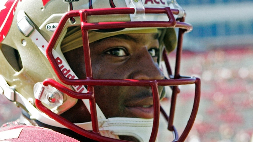 FILE - In this Oct. 5, 2013, file photo, Florida State's Jameis Winston looks around during warms ups prior to an NCAA college football game against Maryland in Tallahassee, Fla. Winston is under investigation in an alleged sexual assault reported nearly a nearly a year ago, the university and Winston's attorney confirmed on Wednesday, Nov. 13, 2013, (AP Photo/Steve Cannon, File)