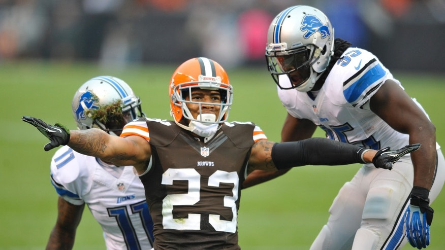 FILE - In this Oct. 13, 2013, file photo, Cleveland Browns cornerback Joe Haden (23) reacts in front of Detroit Lions wide receiver Kevin Ogletree (11) and running back Joique Bell (35) during an NFL football game in Cleveland. The Browns haven't played a significant game this late in the season since 2007, when they just missed the playoffs. On Sunday, they'll face first-place Cincinnati with a chance to move up in the AFC North, deeper into the playoff picture and earn more respectability. (AP Photo/David Richard, File)