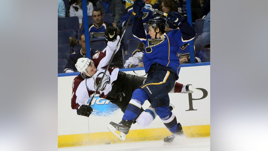 St. Louis Blues right wing T.J. Oshie, right, collides with Colorado Avalanche left wing Jamie McGinn during the second period of an NHL hockey game, Thursday, Nov. 14, 2013, in St. Louis. (AP Photo/St. Louis Post-Dispatch, Chris Lee)  EDWARDSVILLE INTELLIGENCER OUT; THE ALTON TELEGRAPH OUT