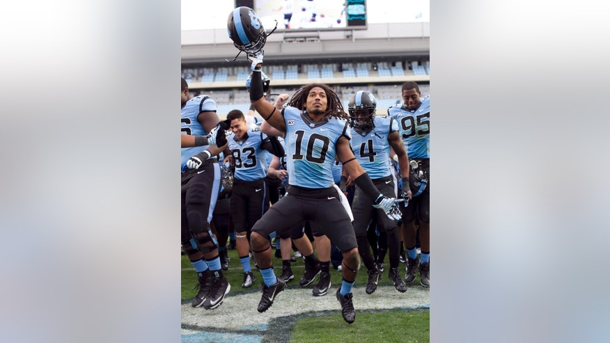North Carolina's Tre Boston (10) and his teammates celebrate their 45-14 victory over Virginia in an NCAA college football game on Saturday Nov. 9, 2013 at Kenan Stadium in Chapel Hill, N.C. (AP Photo/The News & Observer, Robert Willett)  MANDATORY CREDIT