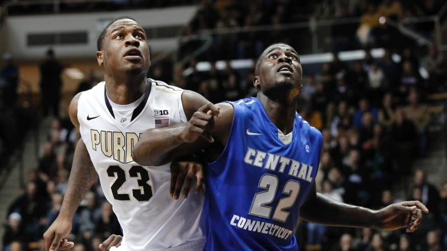 Purdue's Jay Simpson and Central Connecticut State's Faronte Drakeford compete for rebounding position in an NCAA college basketball game Wednesday, Nov. 13, 2013, in West Lafayette, Ind. (AP Photo/Journal & Courier, John Terhune) NO SALES