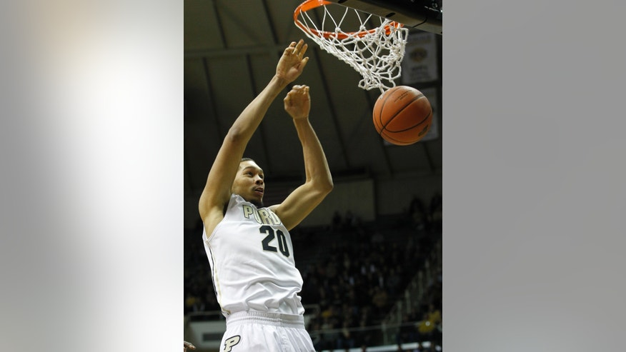 Purdue's A.J. Hammons dunks against Central Connecticut State in an NCAA college basketball game Wednesday, Nov. 13, 2013, in West Lafayette, Ind. (AP Photo/Journal & Courier, John Terhune) NO SALES