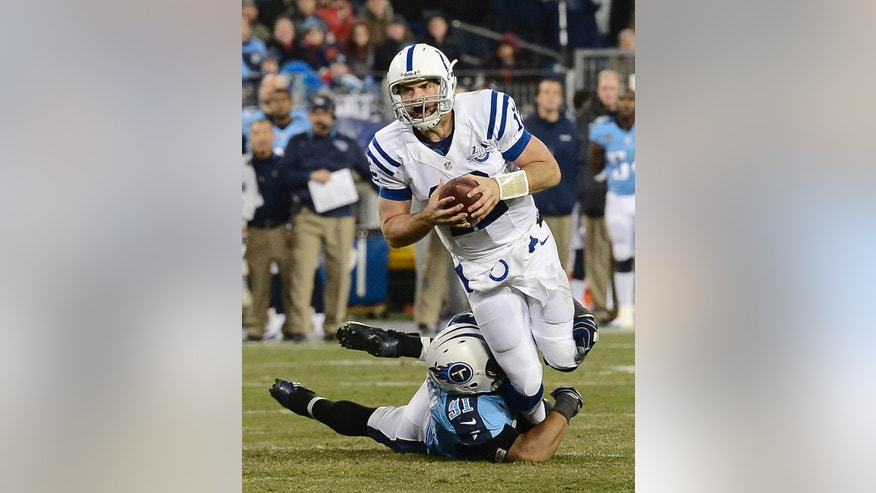 Indianapolis Colts quarterback Andrew Luck (12) is sacked by Tennessee Titans defensive end Derrick Morgan (91) for a 3-yard loss in the second quarter of an NFL football game Thursday, Nov. 14, 2013, in Nashville, Tenn. (AP Photo/Mark Zaleski)