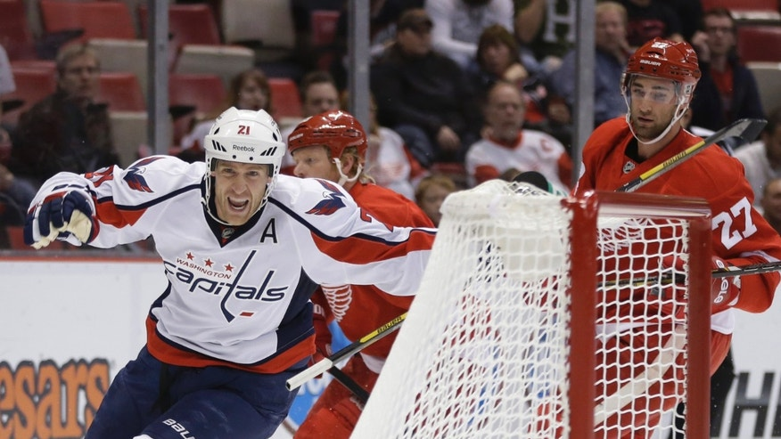 Washington Capitals center Brooks Laich (21) celebrates his goal during the first period of an NHL hockey game against the Detroit Red Wings in Detroit, Friday, Nov. 15, 2013. (AP Photo/Carlos Osorio)