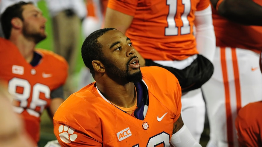 Clemson quarterback Tajh Boyd watches the video screen from the bench during the first half of an NCAA college football game against Georgia Tech, Thursday, Nov. 14, 2013, in Clemson, S.C. (AP Photo/ Richard Shiro)