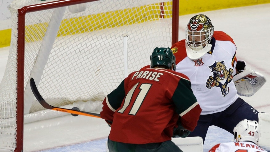 Minnesota Wild's Zach Parise (11) scores a power play goal off Florida Panthers goalie Tim Thomas in the first period of an NHL hockey game on Friday, Nov. 15, 2013, in St. Paul, Minn. (AP Photo/Jim Mone)