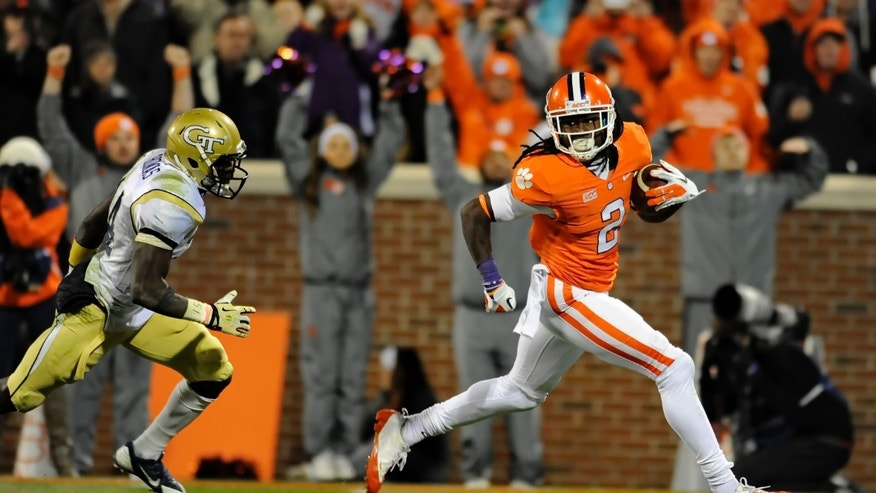 Clemson wide receiver Sammy Watkins races in for a 44-yard touchdown while being pursued by Georgia Tech's Jemea Thomas during the second half of an NCAA college football game Thursday, Nov.14, 2013, in Clemson, S.C. Clemson won 55-31. (AP Photo/ Richard Shiro)