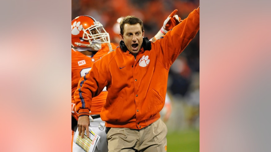 Clemson head coach Dabo Swinney reacts after his team recovered a fumble during the first half of an NCAA college football game against Georgia Tech, Thursday, Nov.14, 2013, at Memorial Stadium in Clemson, S.C. (AP Photo/ Richard Shiro)