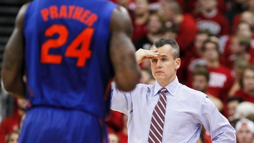 Florida coach Billy Donovan reacts after Kasey Hill (not seen) fouled out during the second half of an NCAA college basketball game against Wisconsin on Tuesday, Nov. 12, 2013, in Madison, Wis. Wisconsin defeated Florida 59-53. (AP Photo/Andy Manis)