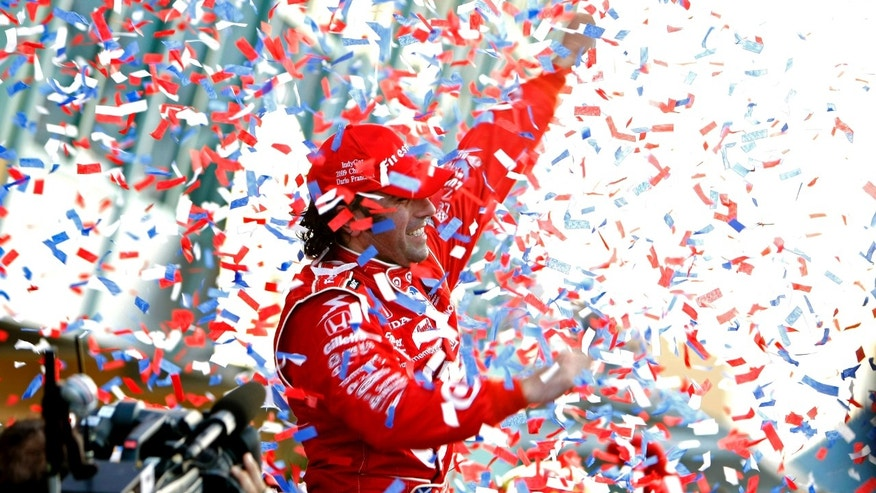 FILE - In this Oct. 10, 2009, file photo, IRL driver Dario Franchitti celebrates after winning the Firestone Indy 300 auto race at the Homestead-Miami International Speedway in Homestead, Fla.   The three-time Indianapolis 500 winner said Thursday, Nov. 14, 2013, that doctors have told him he can no longer race because of injuries sustained in an IndyCar crash last month. He fractured his spine, broke his right ankle and suffered a concussion in the Oct. 6 crash at Houston. (AP Photo/J Pat Carter, File)
