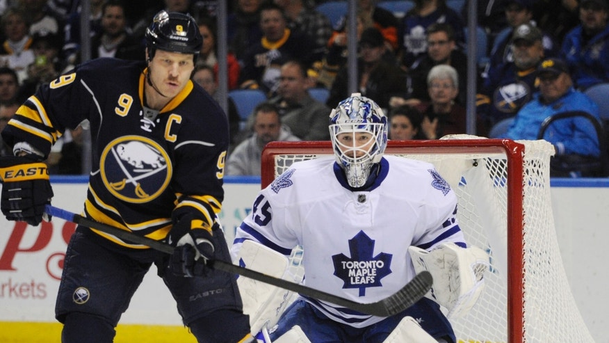 Buffalo Sabres' Steve Ott (9) gets ready to deflect an incoming shot as Toronto Maple Leafs' Jonathan Bernier (45) defends during the first period of an NHL hockey game in Buffalo, N.Y., Friday, Nov. 15, 2013. (AP Photo/Gary Wiepert)