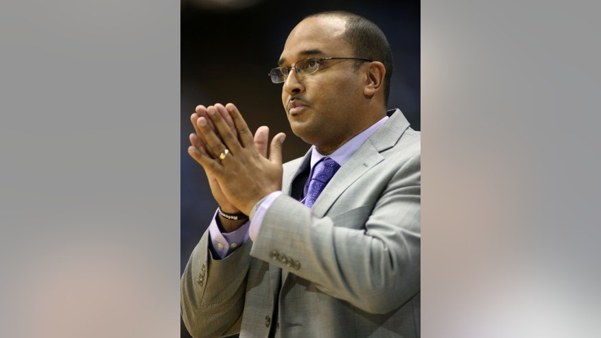 Holy Cross head coach Milan Brown watches the action during the second half of their NCAA college basketball game against North Carolina in Chapel Hill, N.C., Friday, Nov. 15, 2013. North Carolina won 62-54. (AP Photo/Erik Perel)