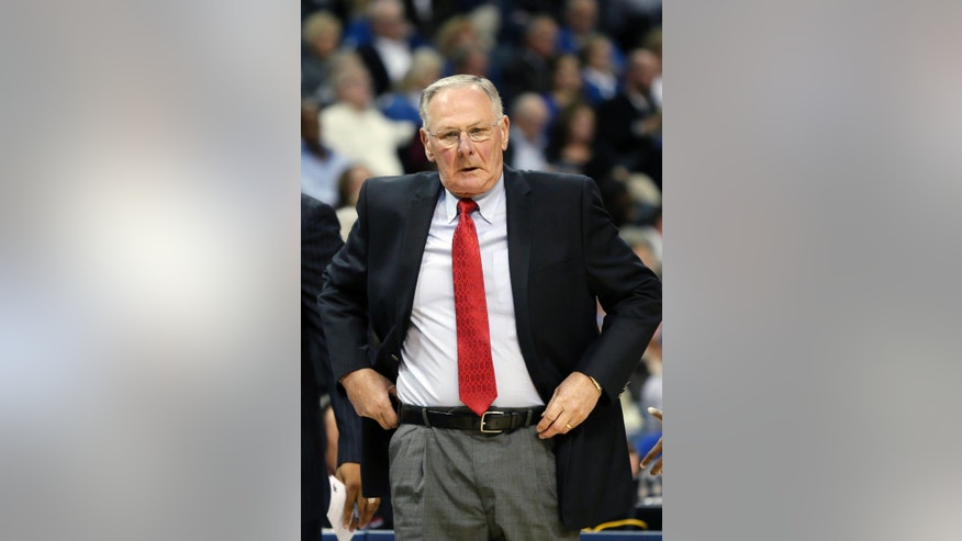 Austin Peay coach Dave Loos walks onto the floor during a time out in the second half of an NCAA college basketball game in Memphis, Tenn., Thursday, Nov. 14, 2013. Memphis defeated Austin Peay 95-69. (AP Photo/Danny Johnston)